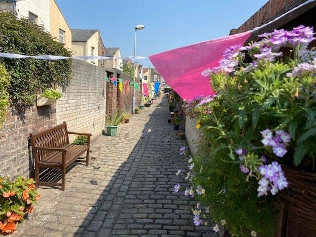 Neighbours in Litherland transform their overgrown alleyway into an amazing community garden