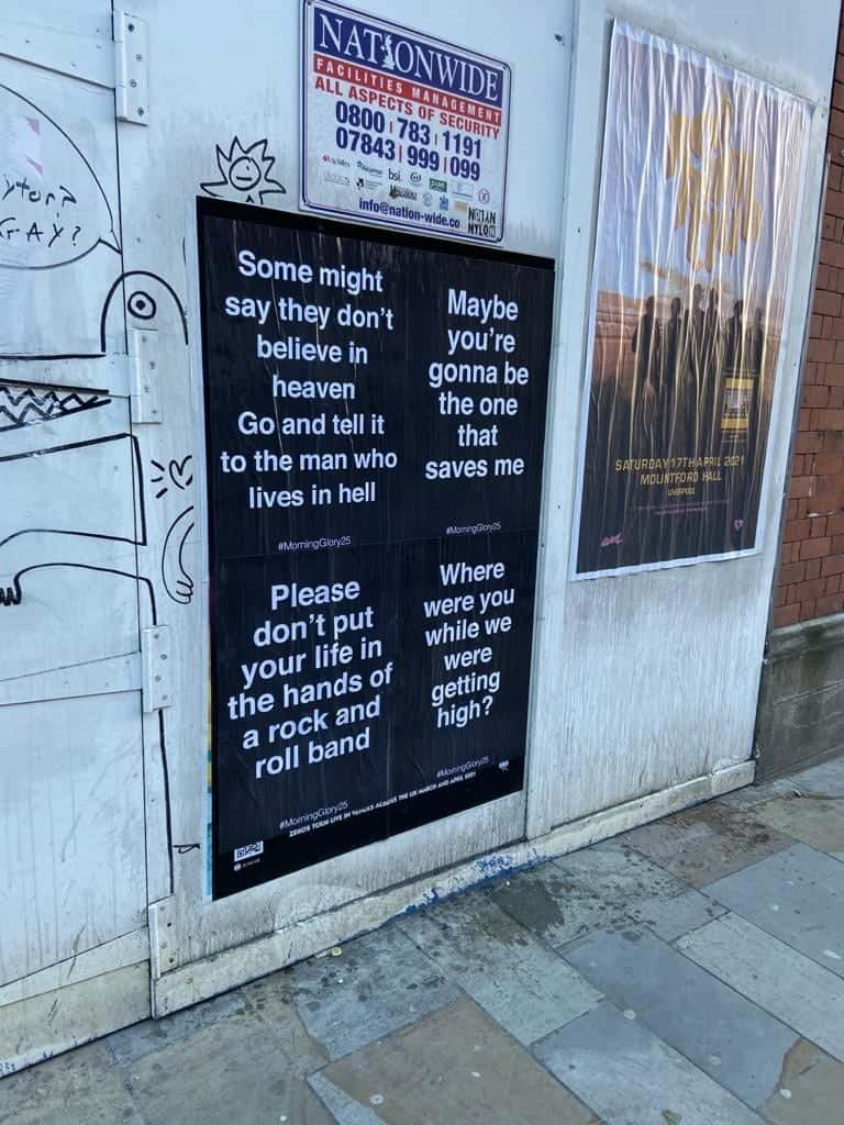 Oasis cryptic posters appear around Liverpool